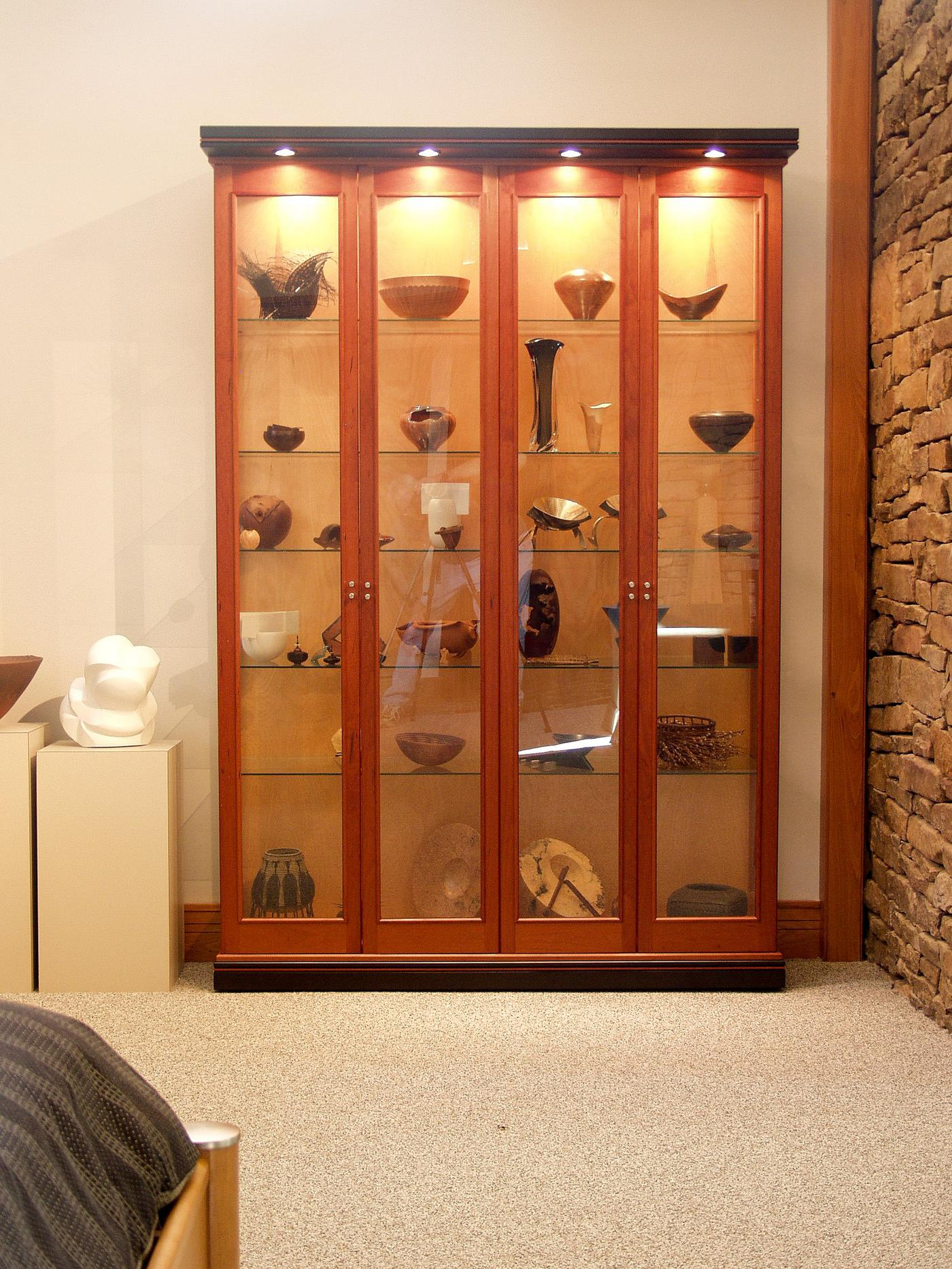 Lighted cherry display cabinet for art collection